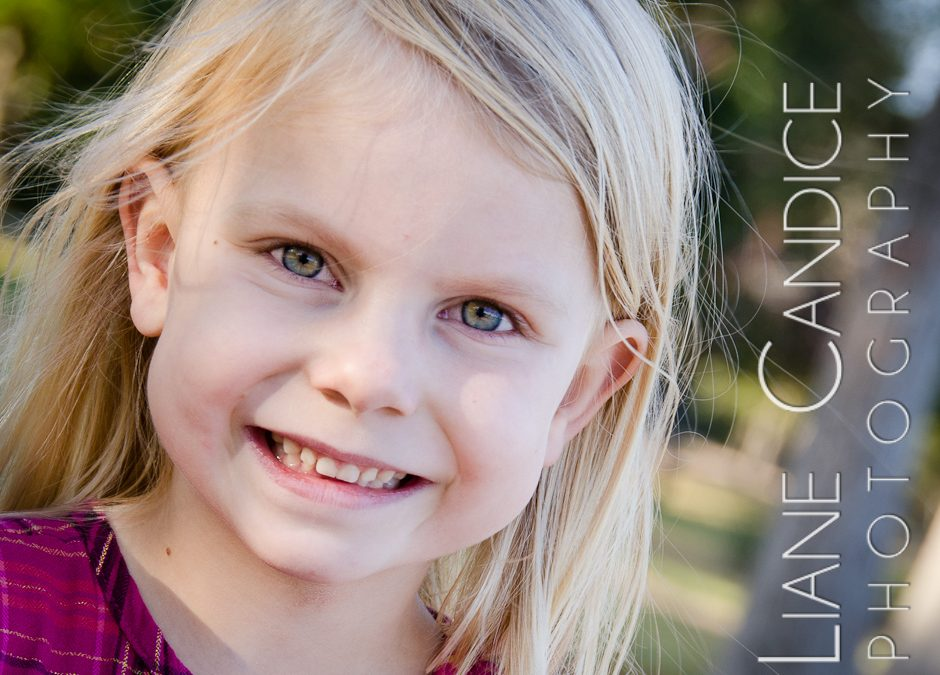 Blond 5 year old smiles for her portrait